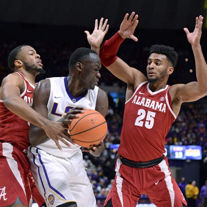 Alabama forwards Galin Smith (30) and Braxton Key (25) defend against LSU forward Duop Reath (1) during the first half of an NCAA college basketball game Saturday, Jan. 13, 2018, in Baton Rouge, La. (Hilary Scheinuk/The Advocate via AP)