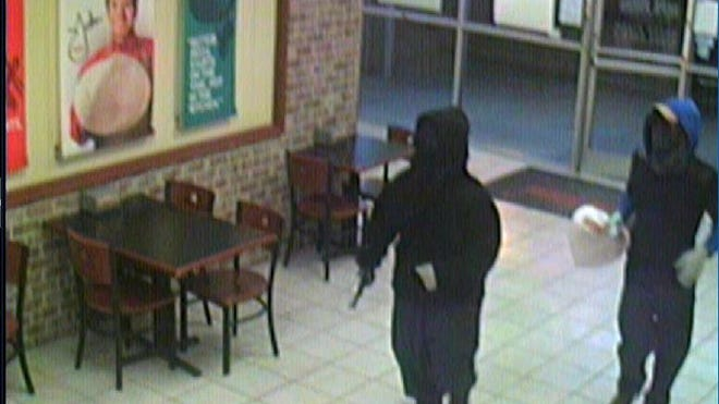 Two suspects are wanted in the shooting of a Papa John's clerk.