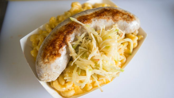 A macaroni and cheese dish with chicken sausage and apple slaw is prepared at Mac'N on Friday in Fort Collins. The food truck changes its menu weekly with all dishes being based on the popular noodle dish.