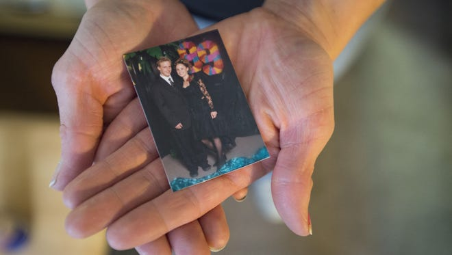 Rebecca Waechter holds a photo from her high school prom in 1999, where she poses with one of her friends who died from an opioid addiction. Waechter was revived by Narcan after her own overdose in 2008 and is hopeful for the future.