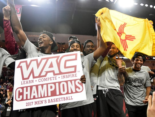 New Mexico State celebrates winning the Western Athletic