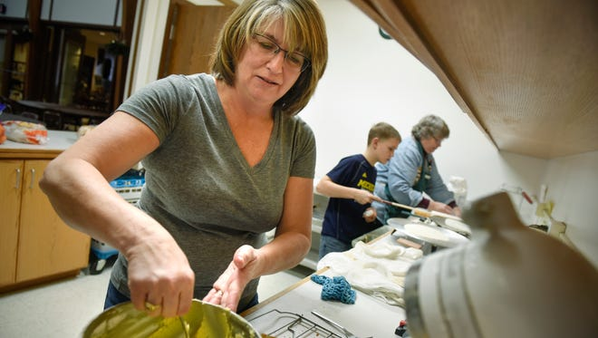 Julie Johnson, left, Carl Shobe and Kathy St. Martin prepare lefse and krumkakor Wednesday, Dec. 7, in preparation for the Santa Lucia Festival of Lights to be held at 7 a.m. Saturday at Salem Lutheran Church in St. Cloud.