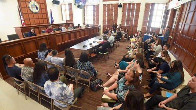 Guam Department of Education employees and others fill the public hearing room as the agency leadership responds to inquiries posed by lawmakers during a budget hearing at the Guam Congress Building in Hagåtña on Wednesday, June 13, 2018.
