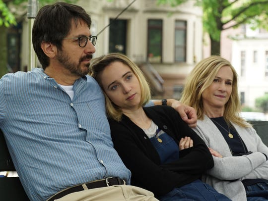 Emily (Zoe Kazan, center) is close to her parents (Ray
