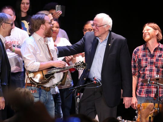 Former presidential candidate Sen. Bernie Sanders, center, and DNC Chair Tom Perez, far left, greeted members of the band Relic following his speech at the Louisville Palace.  