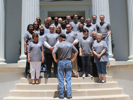 "Gov. Phil Bryant and his staff wore matching T-shirts that bear the phrase, ""Governor Bryant Backs the Badge"" in honor of National Police Week on Friday."