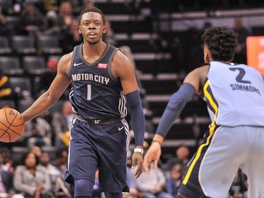 Detroit Pistons guard Reggie Jackson (1) brings the ball up court against Memphis Grizzlies guard Kobi Simmons (2) during the first half at FedExForum.