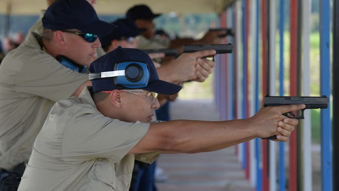 Tyler Spikes works with other cadets during firearms training during the 36th basic academy recently at the CPSO Regional Training Academy in south Caddo Parish.