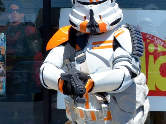 """Members of the 501st Legion's Parjai Squad, the local """"Star Wars"""" costuming group, pose at 3 Alarm Comics in Pensacola during Saturday's Free Comic Book Day. Today is May the Fourth, the unofficial international """"Star Wars"""" Day, and Pensacola has a number of celebrations."""