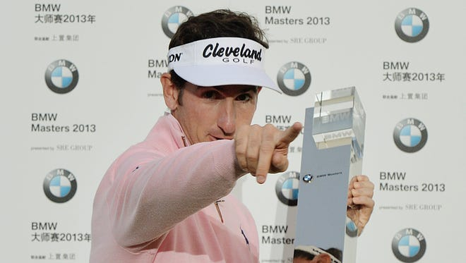 Gonzalo Fernandez-Castano of Spain celebrates with the trophy after winning the BMW Shanghai Masters.