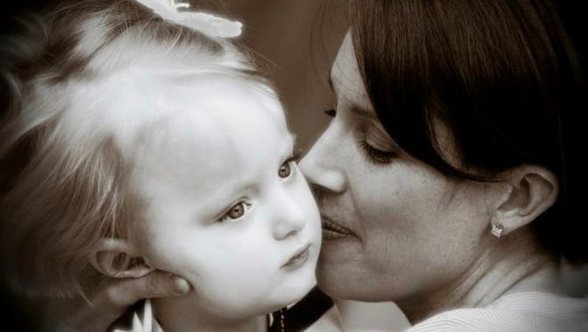 Kerry D'Oretnzio and her daughter, Reese, for whom cannabis oil has greatly reduced her epileptic seizures.