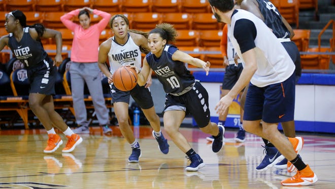 UTEP point guard Faith Cook drives the ball up court during basketball practice in the Don Haskins Center Tuesday morning. Cook has worked her way into a starting role on the team after her play during the first part of the current season. Team mate Jordan Jenkins and Cook have been sharing playing time during the past fifteen games of the 2017-18 season.