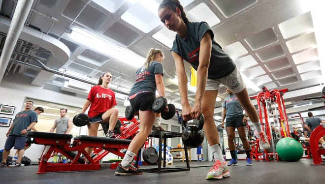 High school and college athletes work out at SUNY Purchase in June.