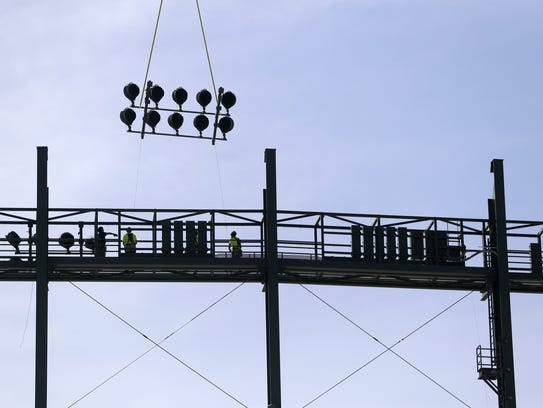 New stadium lights were installed Wednesday at Lambeau Field with the assistance of a helicopter.