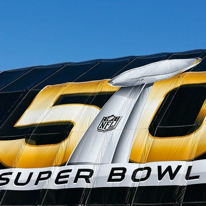A view of the Super Bowl 50 logo on a tent outside