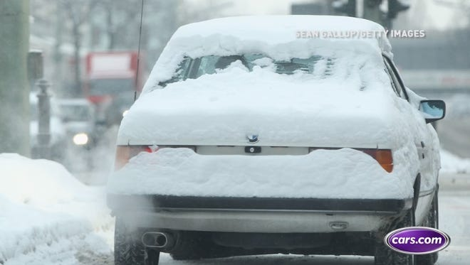 Safely removing snow and ice from your car.