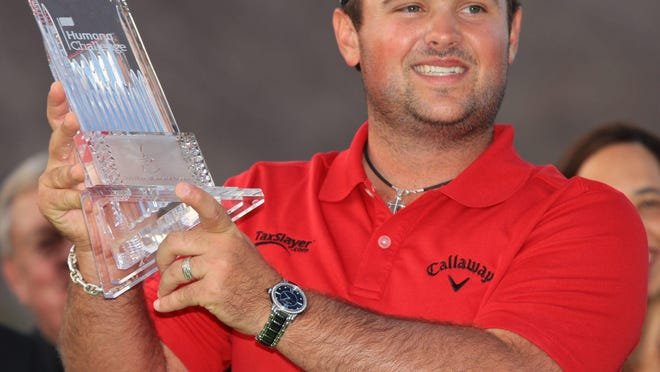 Winner Patrick Reed holds up the trophy for the 2014 CareerBuilder Challenge. Reed won the Masters on Sunday. Crystal Chatham/The Desert Sun
