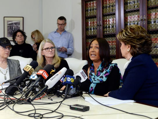 Attorney Gloria Allred, right, with three Cosby accusers.