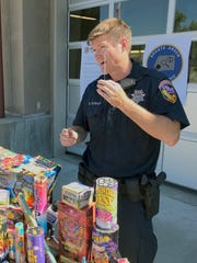 Fire Capt. Specialist Darren Stewart holds a sparkler that's illegal in Shasta County. Stewart said sparklers can not only lead to fires, but burn children who might put them close to their eyes.