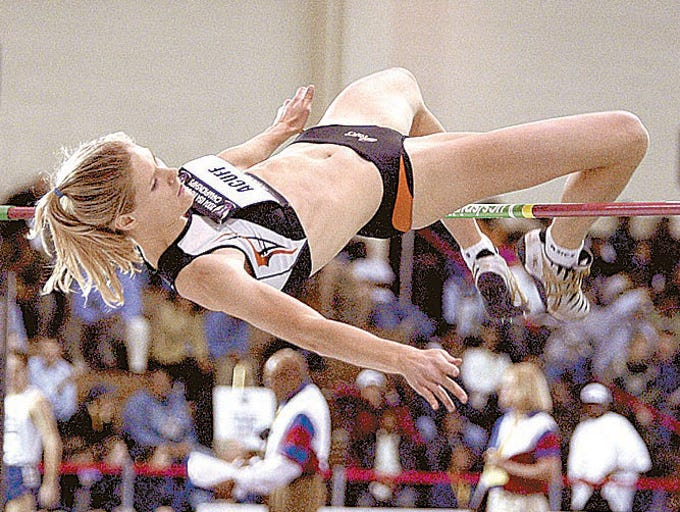Amy Acuff clears the bar at 1.93 meters to win the