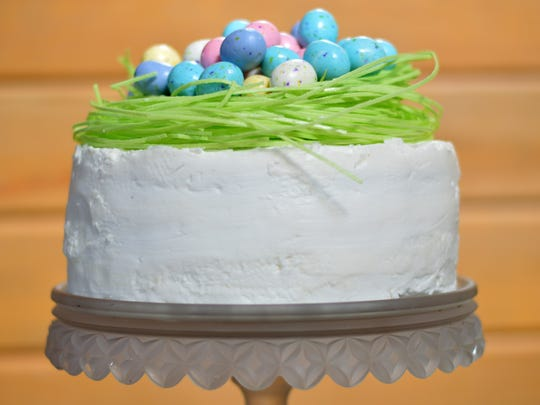 The frosting on this cake is kept white by replacing some of the butter with solid vegetable shortening.