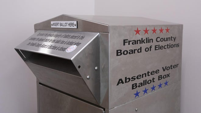 An absentee ballot box sits inside the Franklin County Board of Elections office in Columbus on Wednesday, July 29.