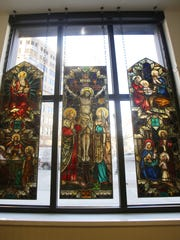 A stained glass window is displayed prominently on