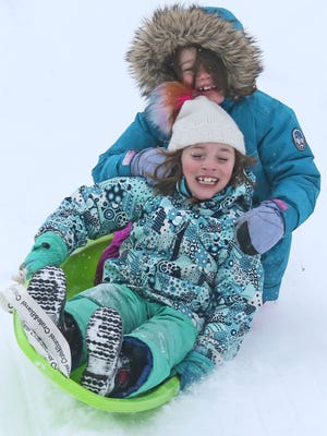 Everything was going perfect while sledding down the hill at Lafayette Hill Rd. and Lincoln Memorial Dr. for Clara Mae Hill age 7 (rear) and Elsie Fisher age 8 (front) both of Shorewood.