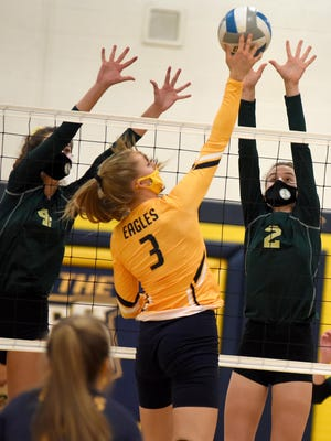 Abbie Costlow (left) and Anna Dean of SMCC go up to block Erie Mason's Angela Sweeney in the first round of the Division 3 District at Mason Monday.