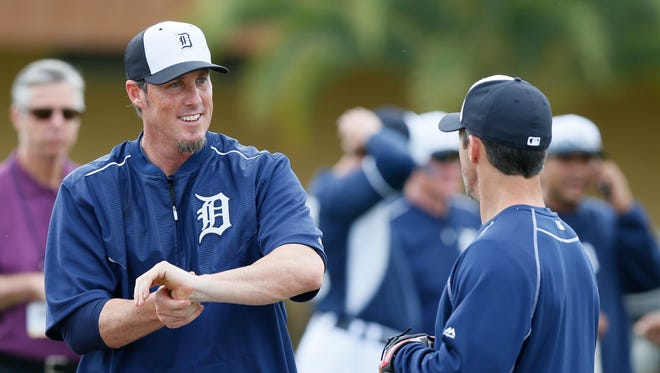 Detroit Tigers Joe Nathan talks with manager Brad Ausmus at the start of practice at Spring Training on Sunday, March 1, 2015 in Lakeland Florida.