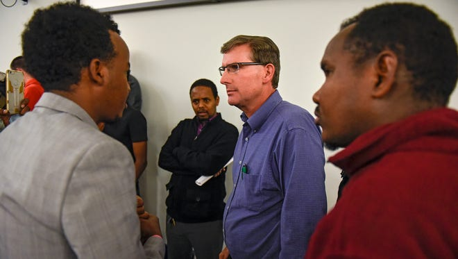 St. Cloud City Council member Jeff Johnson talks to community members following a council meeting Monday, Oct. 23, 2017, at city hall.