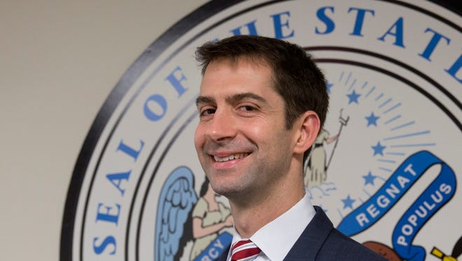 Sen. Tom Cotton, R-Ark. arrives to pose for photographers in his office on Capitol Hill in Washington on Wednesday. The rookie Republican senator leading the effort to torpedo an agreement with Iran is an Army veteran with a Harvard law degree who has a full record of tough rhetoric against President Barack Obama's foreign policy.