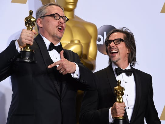 Adam McKay (left) and Charles Randolph pose with their