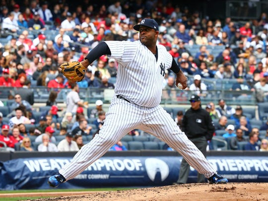 CC Sabathia gets the win by pitching 7 1/3 innings, allowing one run on three hits and striking out six to get the win against the St. Louis Cardinals on Saturday at Yankee Stadium.
