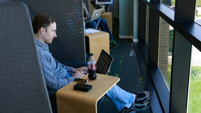 Web developer Jeff Barron works in a quiet space that designed for the 20-20-20 rule — every 20 minutes, look away from the computer at least 20  feet away for 20  seconds.