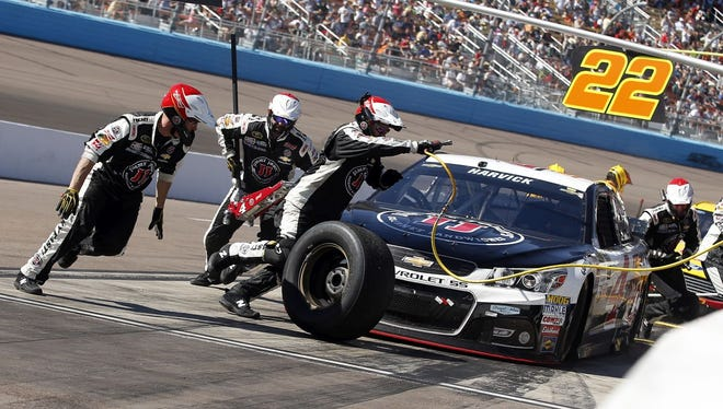 Kevin Harvick pits during a NASCAR Sprint Cup Series auto race on Sunday, March 15, 2015, in Avondale, Ariz.