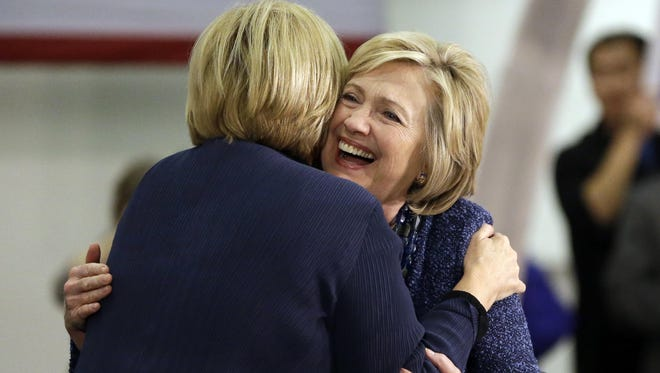 LEFT: Democratic presidential candidate Hillary Clinton hugs Sen. Claire McCaskill, left, before speaking to supporters during a campaign stop at a union hall on Dec. 11 in St. Louis. ABOVE: Sen. Roy Blunt.