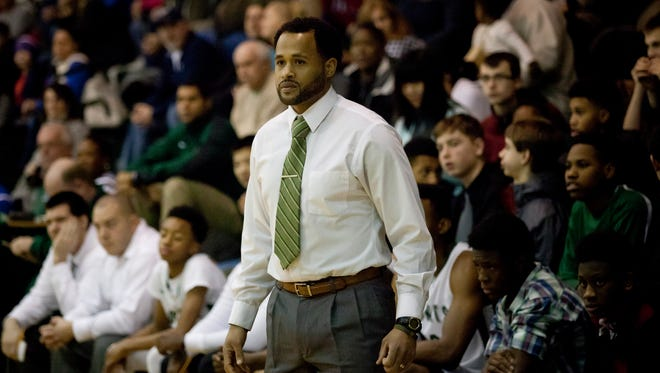 New Haven coach Tedaro France II watches the action from the sidelines during a basketball game Tuesday, Jan. 12, 2015 at New Haven High School.