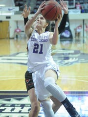 ACU's Kayla Galindo (21) drives to the basket against Incarnate Word. The Wildcats beat Incarnate Word 58-56 in the Southland Conference game Saturday, Feb. 10, 2018 at Moody Coliseum.