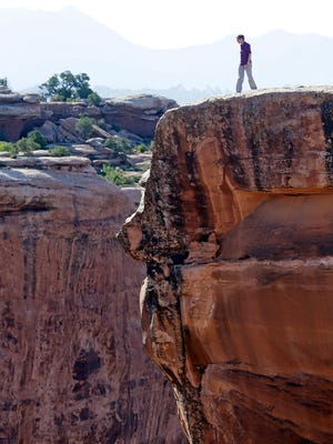 "U.S. Interior Secretary Sally Jewell looks in to a canyon at Gemini Bridges during a tour Thursday, July 14, 2016, near Moab, Utah. Jewell visited the area to meet with proponents and opponents the latest indication the Obama administration is giving serious consideration to the ""Bears Ears"" monument proposal. The issue has become the latest battleground in the debate over public lands in the West."