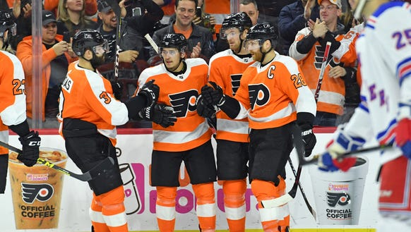 Travis Konecny, center, scored a pair of goals in the