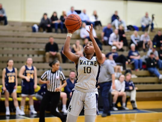 Going up for a basket Monday night is Wayne Memorial junior Jeanae Terry (10).