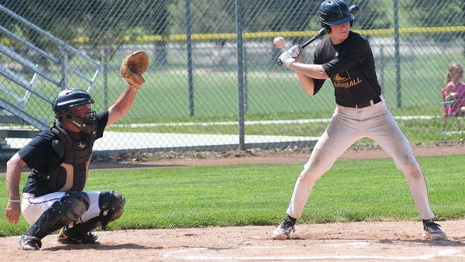 A Newton Knight batter takes a pitch during the alumni game Saturday at Klein-Scott Field.
