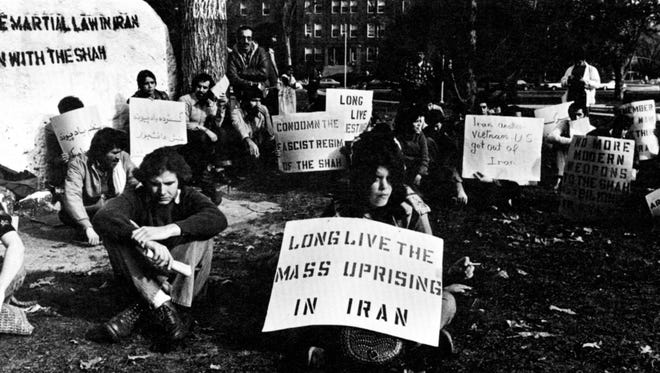 """The Rock"" - the memento from the Class of 1873, has become a popular gathering place for protests such as this one, Nov. 10, 1978."