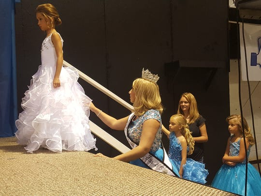 Moments before walking across the stage, Lainey Brooke Collins prepares to compete in the Tiny Miss Augusta County Fair. Collins is the daughter of Rodney and Jennifer Collins of Waynesboro. Collins was crowned later that day with the Tiny Miss title.