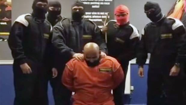 A video posted on Instagram showed five men wearing balaclavas making a colleague in an orange jumpsuit kneel down.