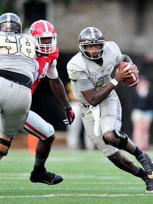 Vanderbilt quarterback Johnny McCrary looks downfield during the fourth quarter against Georgia last Saturday. McCrary has been more effective at a higher tempo.