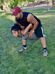 Valetina Castaneda and Greg Kirkley begin a lift move