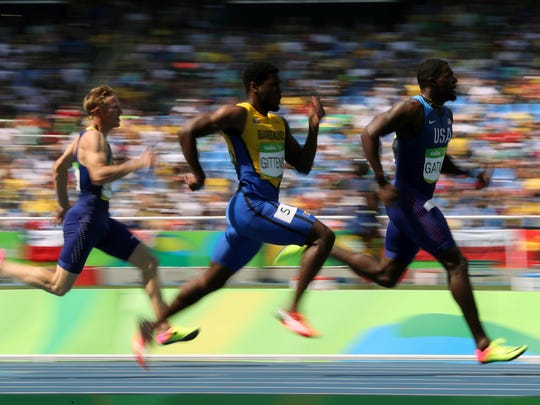 United States' Justin Gatlin, right, competes in a men's 200-meter heat during the athletics competitions of the 2016 Summer Olympics at the Olympic stadium in Rio de Janeiro, Brazil, Tuesday, Aug. 16, 2016. (AP Photo/Lee Jin-man)