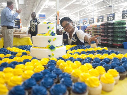 Walmart's Jacqueline Williams arranges fresh cupcakes at the bakery section at Walmart in Williamstown. Williams is one of 50 recent graduates of the newly-opened training academy at the Walmart in Williamstown. The academy is the first the retail giant has opened in New Jersey and is among 200 that will be opened across the country. Williams is a claims supervisor.